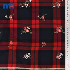 embroidered tartan fabric